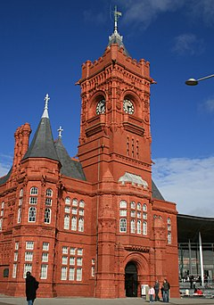 Red brick building with large central clock tower