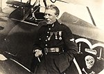 Portrait of Charles Nungesser, French WWI ace, standing beside his Nieuport.jpg