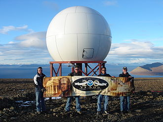 Svalbard Satellite Station - NOAA employees in front of one of NOAA's antennas