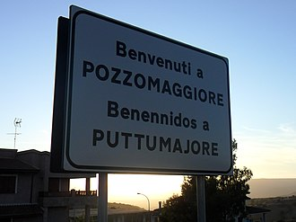 A bilingual road sign in Italian and Sardinian at Pozzomaggiore. Pozzomaggiore cartello.jpg