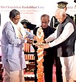 Pranab Mukherjee lighting the lamp to inaugurate the Centenary Celebrations of the University of Mysore, in Karnataka. The Governor of Karnataka, Shri Vajubhai Rudabhai Vala and the Chief Minister of Karnataka.jpg