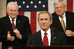 President George W. Bush alongside Dick Cheney and Dennis Hastert presents his fourth State of the Union address at the U.S. Capitol, February 2, 2005.jpg