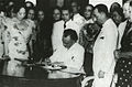 President Quezon signing the Women's Suffrage Bill.jpg