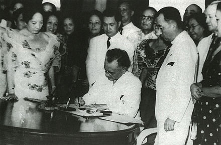 President Quezon signing the Women's Suffrage Bill following the 1937 plebiscite President Quezon signing the Women's Suffrage Bill.jpg