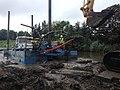Prime Hook National Wildlife Refuge marsh restoration - pulling Victory on bank for repair (21332656711).jpg