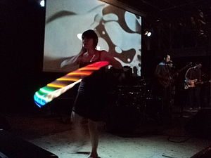 Psychedelia - A retro example of psychedelia; hula hoops with LEDs did not exist in the 1960s.