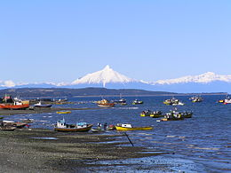 Quellon's Coastline with Volcano Corcovado in the distance.JPG