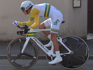 Porte in his national time trial champion s jersey onboard his custom  painted Bolide (left) Bradley Wiggins wearing the rainbow skinsuit at the  2015 ... e68357be4