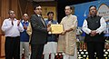 "Radha Mohan Singh presented the awards, at the inauguration of a Conference with theme ""Nutritional & Income Security through Eggs"", on the occasion of the World Egg Day, 2016, in New Delhi.jpg"