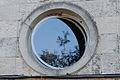 Refection in a Round Window (1) (8596440743).jpg