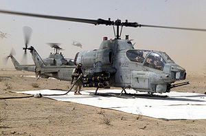 Marine Wing Support Squadron 373 - Cobra attack helicopters being refueled at a MWSS-373 FARP during Operation Iraqi Freedom.