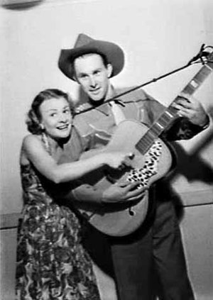 Reg Lindsay - Reg Lindsay (right, with guitar) and Joan Clarke on the Hour of Song radio program, 2UW Radio Theatre, Sydney (1954)