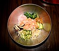 Rice and raw salmon and vegetables at Korean restaurant.jpg