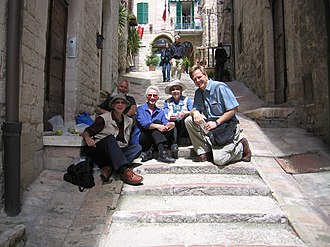 Rick Steves - Tourists in Italy encounter Rick Steves on a backstreet, using his book as a guide.