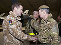 Royal Air Force (RAF) Gen. Nicholas Houghton, right, the Vice Chief of the Defense Staff of the British armed forces, greets an RAF member assigned to the 62nd Expeditionary Reconnaissance Squadron during 120123-F-XH170-079.jpg