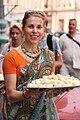 Russian Hare Krishna with a plate of prasadam.jpg