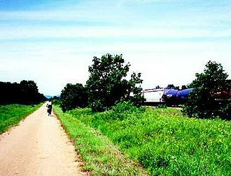 "Rail trail - A ""rail with trail"" in the United States; train at right"