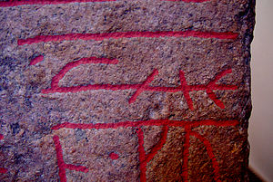 "Sønder Kirkeby Runestone - Detail showing the same-stave bind rune for the word runaʀ or ""runes."""
