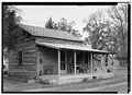 SOUTH AND WEST ELEVATIONS - Dr. Irvin D. Leoser Log Cabin, 119 West Smith Street, Tahlequah, Cherokee County, OK HABS OKLA,11-TAHL,5-2.tif