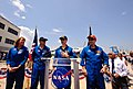 STS-135 crew speak at landing site.jpg