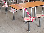 Tables and seats cordoned off with tape