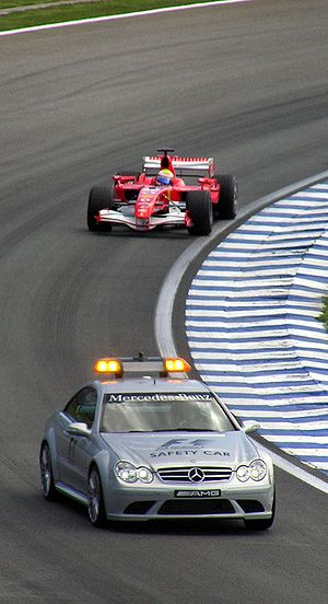 Bernd Mayländer - Mayländer leading the race leader, Felipe Massa, and other drivers at the 2006 Brazilian GP.