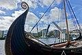 Saga Oseberg viking ship replica 2012 Fore bow carvings Forstavn Tønsberg harbour havn dock Brygga Lindahlplan Kaldnes bro gangbru vippebro Open bascule footbridge DSB, etc Norway 2019-08-16 DSC04279.jpg