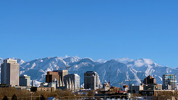 View of a city with snow-capped mountains in the background