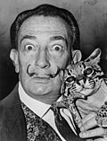 Salvador Dalí with his pet ocelot Babou