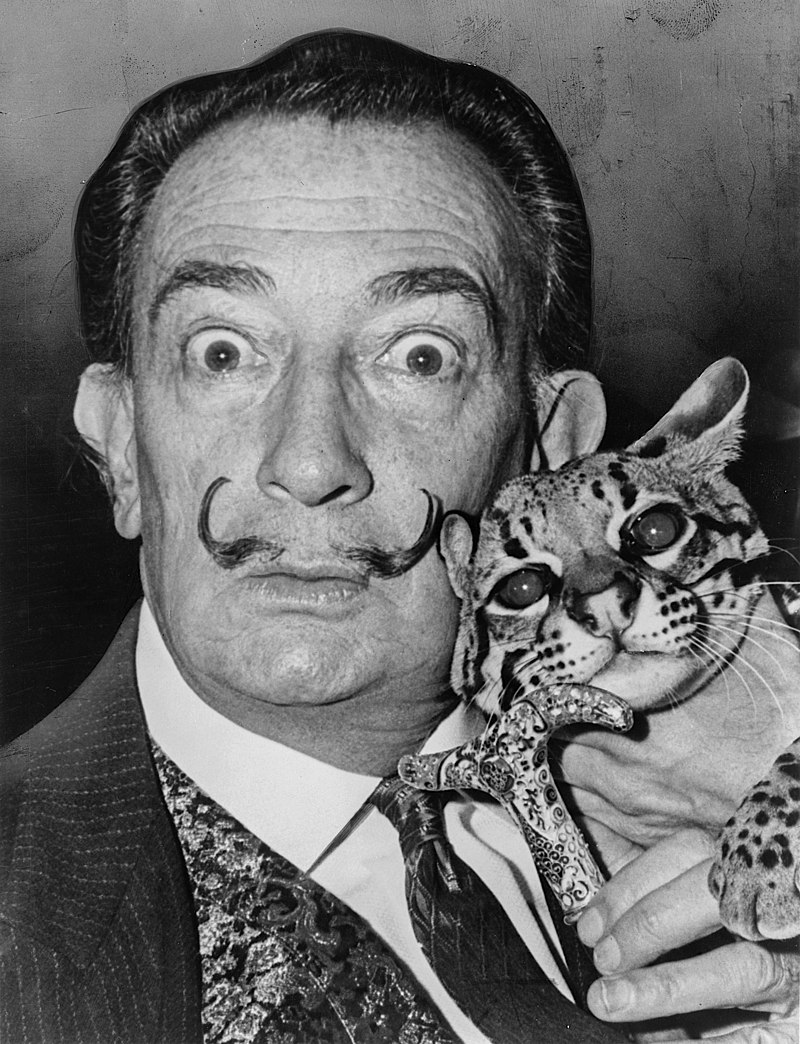 Dalí in the 1960s sporting his characteristic flamboyant moustache. Photographed holding his pet ocelot