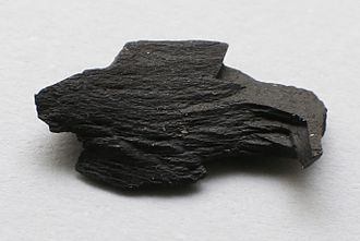 Jet (lignite) - Sample of unworked jet (about 15 mm long)
