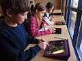 School children with iPads (6660064659).jpg