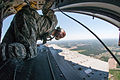 Sgt. 1st Class Garrett Williams looks for visual cues that his CH47 Chinook helicopter is approaching the drop zone so that he can ready the paratroopers aboard.jpg