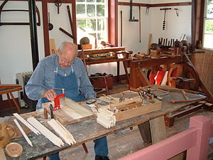 Craft production - A craftsman making boxes in the manner of the 19th century Shakers.