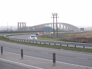 Isle of Sheppey - The Sheppey Crossing with the towers of the Kingsferry Bridge seen from the island