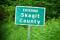Sign entering Skagit County on Washington State Route 9 northbound.jpg