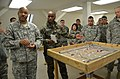 Sous-Lieutenant Fabrice Guy briefs the 557th ASMC, utilizing his sand table for orientation 150128-A-UA479-770.jpg