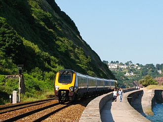 South Devon Railway sea wall - A CrossCountry Class 221 passes walkers near Teignmouth