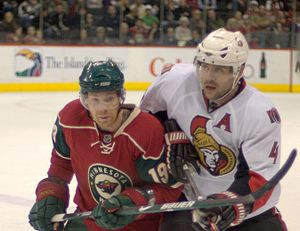 Minnesota Wild - Stephane Veilleux in the red home jersey. It was originally the team's third jersey from 2003–07.
