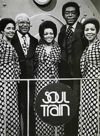 Don Cornelius - Cornelius (second from right) with The Staple Singers during production of a 1974 episode of Soul Train.