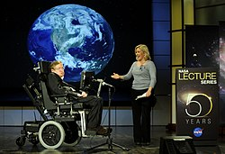 Photograph of Hawking and his daughter Lucy on-stage at a presentation