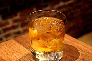 Stinger (cocktail) - Stinger cocktail served over ice in a rocks glass.