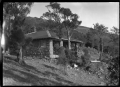 Stone house with pillars at the front of a deep verandah ATLIB 315078.png