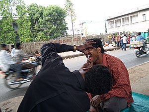 English: Street dentist in Bangalore with a pa...