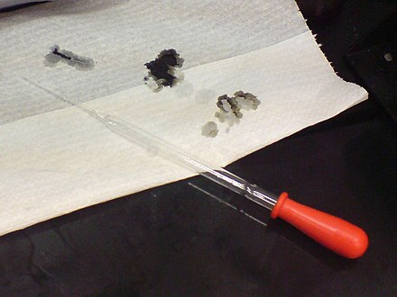 Drops of 98% sulfuric acid char a piece of tissue paper instantly. Carbon is left after the dehydration reaction staining the paper black. Sulfuric acid burning tissue paper.jpg