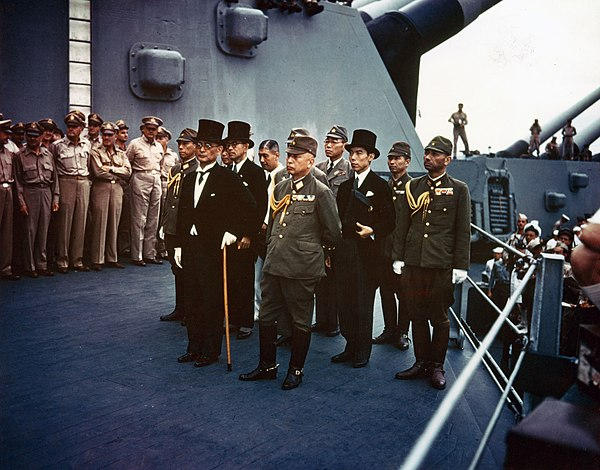 Representatives of the Empire of Japan stand aboard USS Missouri prior to signing of the Instrument of Surrender. Surrender of Japan - USS Missouri.jpg