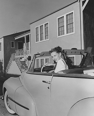 Susan Peters - Peters driving in October 1947; her vehicle was refitted with a hand-accelerator and brakes to allow her to drive after her paralysis