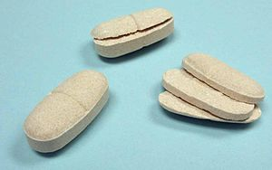 Tablet (pharmacy) - Tablets that failed due to capping and lamination compared to a normal tablet