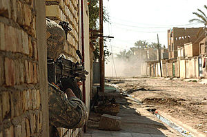 Battle of Baqubah - A soldier assigned to the 1st Platoon, Company B, 1-12 Combined Arms Battalion, 3rd Brigade Combat Team, 1st Cavalry Division, guards a street in the neighborhood of Tahrir in Baqubah, Iraq, 28 March 2007
