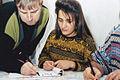 Teacher shows Iran female calligraphy.jpg